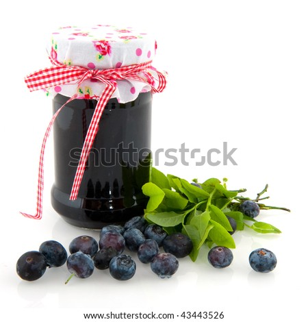 Home made fruit jam from tasty blue berries in glass pot