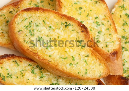 Home-made garlic and herb bread. - stock photo