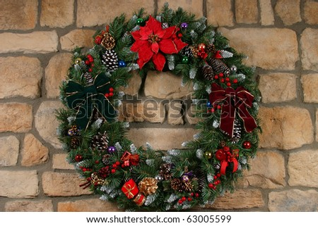 Home Made Holiday Wreath Hanging On Stone Wall Stock Photo
