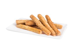 Home made salty sticks snack with cheese  isolated on a white plate