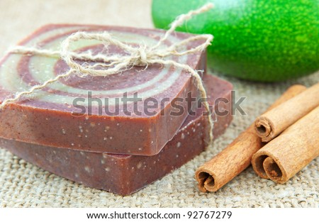 Home-made soap with avocado and cinnamon sticks