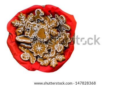 Home-made sugar-icing gingerbread cookies are beautiful Christmas decoration and delicious sweeties. Isolated