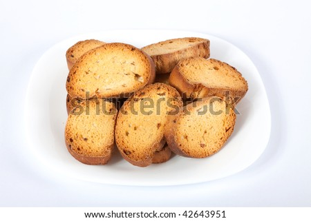 Home-maid rusk with raisins on plate. Clipping path included.