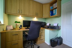 Home office or study, in a converted bedroom, fitted with desk and cupboards