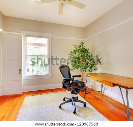 Home office room interior with desk and beige walls.