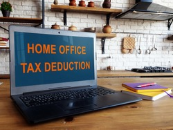 Home office tax deduction information on laptop screen.