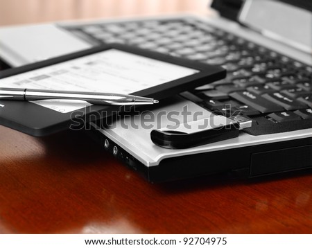 Home office with laptop, pen, phone and USB stick