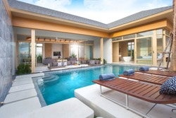 home or house building  Exterior  and interior design showing tropical pool villa with sun bed and blue sky