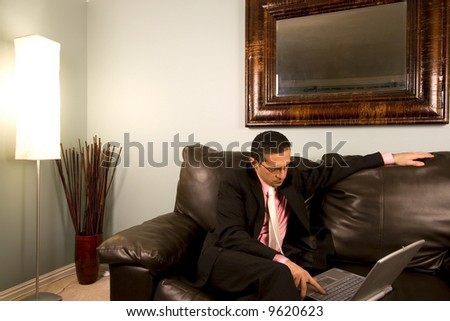 Home or Office - Businessman with his Glasses working on the Couch - stock photo