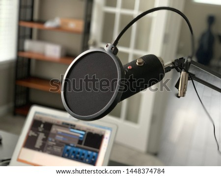 Home podcasting setup with microphone