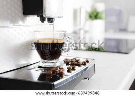Home professional coffee machine with espresso cup. coffee machine espresso kitchen cup hot italian white concept #639499348