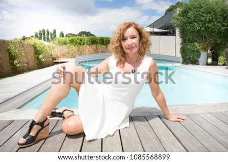 home real estate and people concept happy senior woman over living house background stock photo