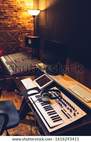 home recording studio interior and professional audio equipment