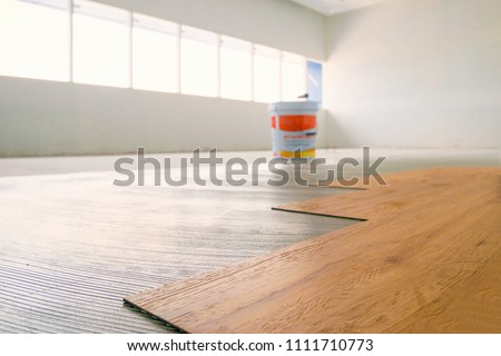 Home renovate with vinyl laminate flooring.
