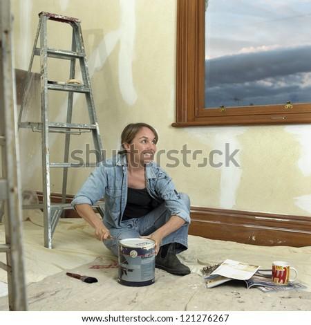 Home renovating, woman mid-thirties