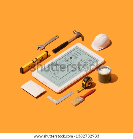 Home renovation and project design app on a touch screen tablet and isometric DIY construction tools on a smartphone