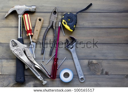 home renovation in progress. various tools against wooden surface, add your text.