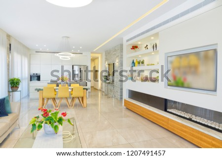 Home Renovation -  Modern Living Room With Big TV Screen And Kitchen In Background