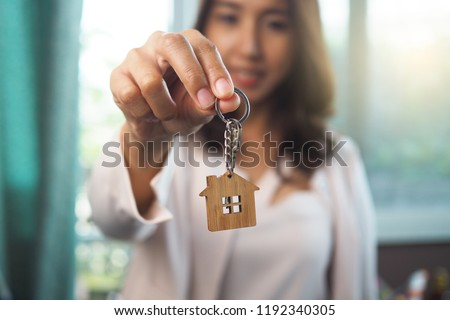 Home sales agents are giving home keys. Rent a house, buy and Sell concept