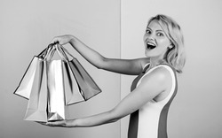 Home shopping. summer discount. special offer on black friday. shop closeout. happy woman shopper. big sale. female shopaholic hold shopping bags. present packages for holiday preparation.