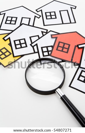 home sign and Magnifying Glass , Real Estate Concept