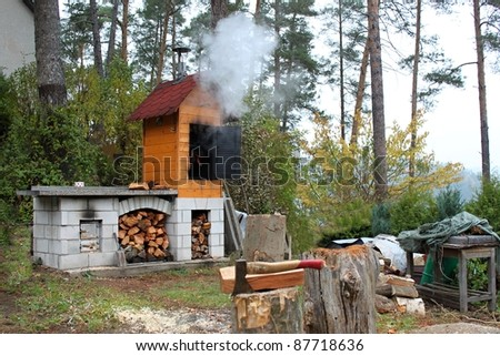 home smokehouse in the woods