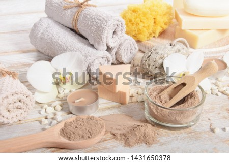 home spa, candles, pumice, natural soap, dry powder for making a face mask,