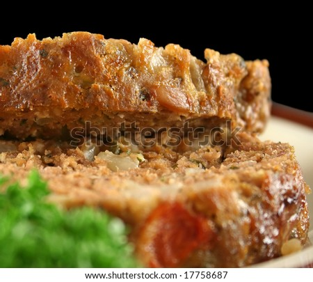 Home style lamb meatloaf with salad ready to serve.