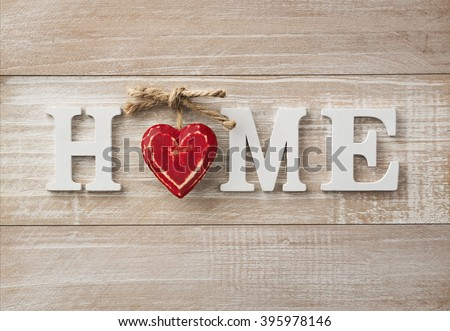 Home sweet home, wooden text on vintage board background with copy space #395978146