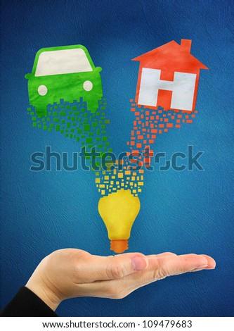 home symbol and car symbol over hand