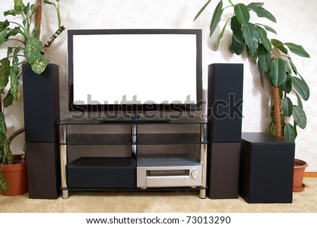 Home theater with empty white isolated screen