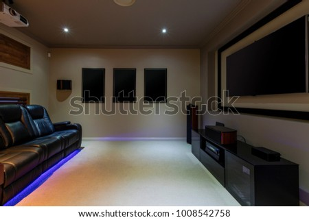 Home thetre room with projector and leather lounges #1008542758
