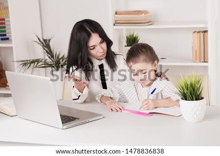 Home tutor concept. Doing homework together.