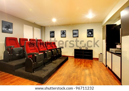 Home TV movie theater entertainment room interior with real cinema chairs. #96711232