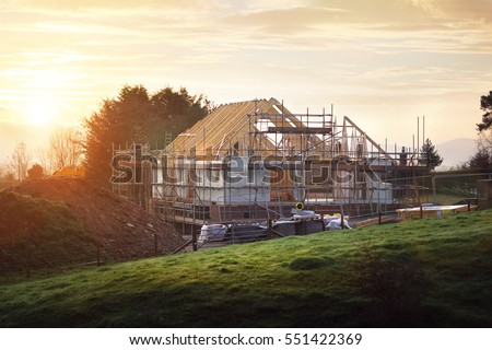 Home under construction on a building site #551422369