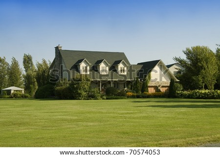 Home with beautiful landscaping in the country