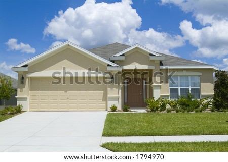 Home with blue sky and clouds background 11 - stock photo
