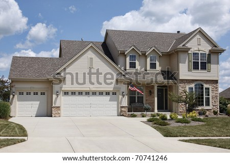 Home with covered entry and double three car garage #70741246