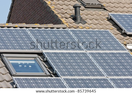 Home with roof and solar panels