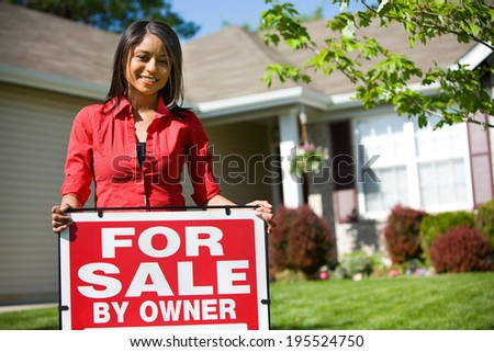 Home: Woman Stands Behind For Sale By Owner Sign