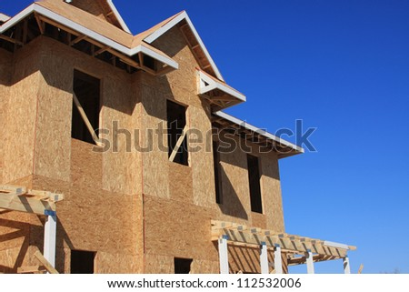Home wooden framework with plywood and boards of a new home development - stock photo