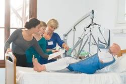 homecare nurses hoisting a dummy