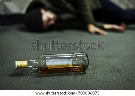 Homeless Alcoholism Drunk Man Sleeping on The Floor #709806073