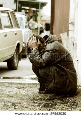 Homeless beggar.