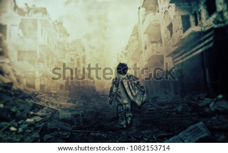 Homeless child walking in destroyed city /No hope for the future