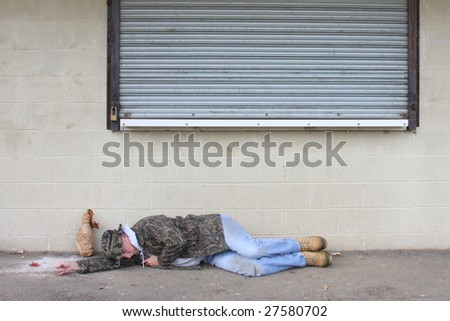 Homeless man asleep on the sidewalk