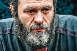 Homeless man crying portrait closeup