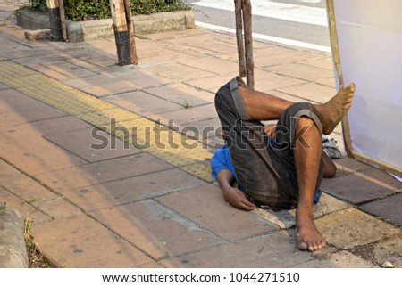 Homeless man sleep on street in Thailand. Concept social problems of poverty. #1044271510