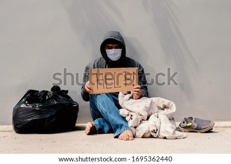 homeless man unemployed on the street due to corona virus covid 19 and need help Сток-фото ©