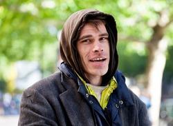 Homeless Men Being Friendly standing Outdoor